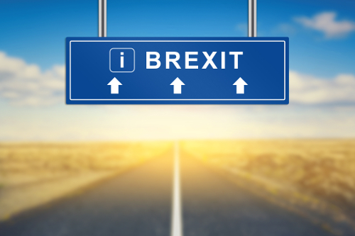 Brexit or British exit words on blue road sign with blurred background